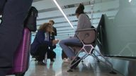 A family is spoken to at Heathrow about female genital mutilation