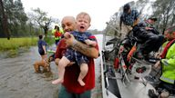 Oliver Kelly, 1 year old, cries as he is carried off the sheriff's airboat during his rescue from rising flood waters in the aftermath of Hurricane Florence in Leland, North Carolina