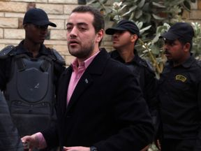 Al Jazeera journalist Baher Mohamed stands outside a court in Egypt in 2015