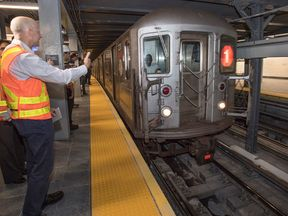 MTA New York Transit President Andy Byford greeted the first train to stop at the station for service. It was a northbound 1 train that arrived at 12:01 p.m. Pic: MTA New York