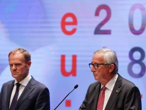 European Council President Donald Tusk and European Commission President Jean-Claude Juncker hold a news conference after the informal meeting of European Union leaders in Salzburg