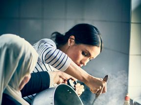 The Duchess of Sussex has spent time cooking with women in the Hubb Community Kitchen. Pic: Jenny Zarins