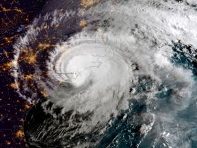 In this NOAA satellite handout image captured at 7:45 a.m. ET, shows Hurricane Florence as it made landfall near Wrightsville Beach, North Carolina on September 14, 2018