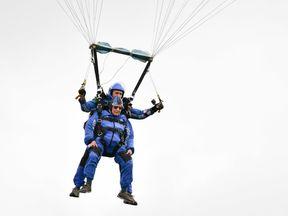 Harry Read descends under his parachute