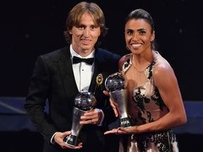 Luka Modric and Marta after collecting their trophies