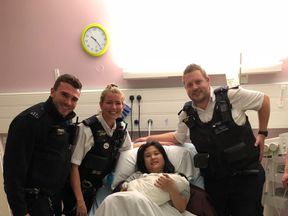 The woman gave birth just five minutes after officers arrived at the scene
