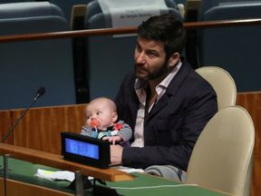 Clarke Gayford, partner to New Zealand Prime Minister Jacinda Ardern holds their baby Neve at the Nelson...