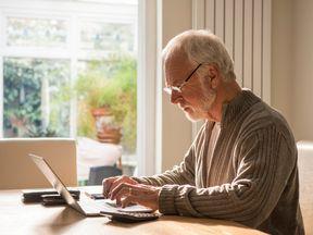 Old man at a computer