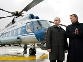 Vladimir Putin with former defence minister Sergei Ivanov on the roof of the GRU's new headquarters in 2006
