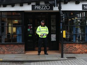 A police officer outside the Prezzo restaurant in Salisbury, where a couple had become unwell after exposure to an unknown substance