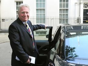 Mike Penning MP for Hemel Hempstead leaves 10 Downing Street, London, as Prime Minister David Cameron, kicked off a coalition reshuffle, with Scottish Secretary Michael Moore among the casualties.