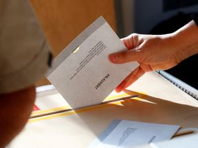 A ballot is dropped into the box at a polling station in Stockholm