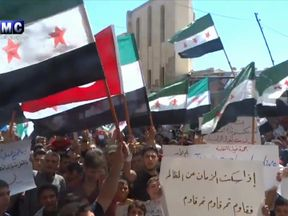 People protest in Idlib against a possible government offensive