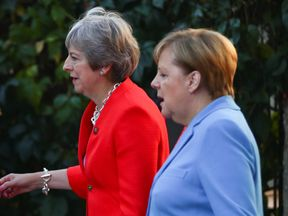 German Chancellor Angela Merkel and Britain's Prime Minister Theresa May arrive for the informal meeting of European Union leaders in Salzburg