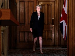 Theresa May arrives to make a statement on Brexit negotiations