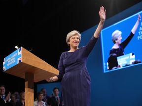 """British Prime Minister Theresa May delivers her keynote speech to delegates and party members on the last day of the Conservative Party Conference at Manchester Central on October 4, 2017 in Manchester, England. The prime minister rallied members and called for the party to """"shape up"""" and """"go forward together"""". Theresa May also announced a major programme to build council houses and a cap on energy prices."""