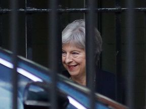 Theresa May leaves via the back entrance of 10 Downing Street