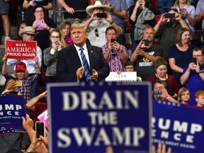 US President Donald Trump waves to the crowd during a 'Make America Great Again' rally in Billings, Montana on September 6, 2018