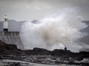 Waves hit the seafront in Porthcawl, Wales