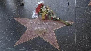 Flowers on Burt Reynolds Walk of Fame square.