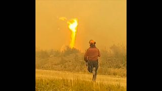 Fire tornado pulls fire hose over 100ft in the air