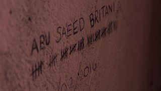 The name of an apparently British victim inscribed on the walls at IS's death prison in Raqqa