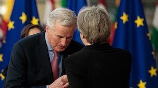 Michael Barnier greeting Theresa May at the European Council leaders' summit in March 23