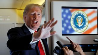 The president made the comments to reporters on Air Force One