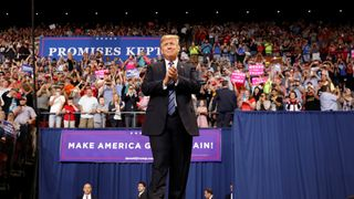 """U.S. President Donald Trump greets the crowd as he arrives for a """"Make America Great Again"""" rally in Billings, Montana U.S., September 6, 2018"""
