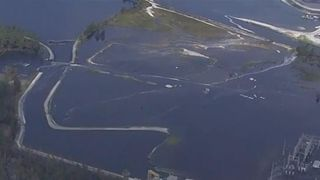 North Carolina dam is breached, flooding the surrounding area