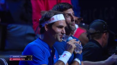Federer and Djokovic chat on bench