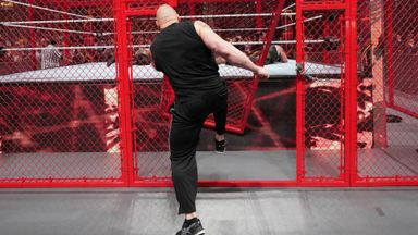 Lesnar invades Hell In A Cell by smashing door