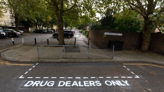 Community activists erect hoax street signs in residential streets near Columbia Road. Pic: Vickie Flores/LNP/REX/Shutterstock