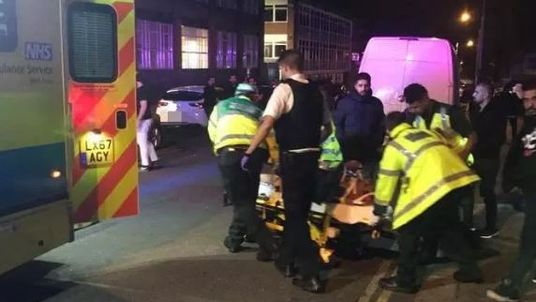 Paramedics attend to injured people