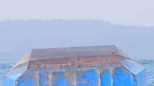 The ferry's rusting hull was all that could be seen of it on Friday