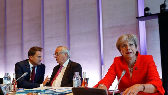 Theresa May, European Commission President Jean-Claude Juncker and Luxembourg's Prime Minister Xavier Bettel
