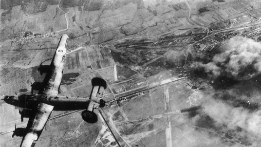 A Liberator bomber of the US Army Air Force returns to its home base after bombing a German airfield near St Dizier, in occupied France