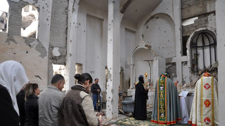 A Christian Syriac patriarch holds mass at a heavily damaged church in Deir Ez Zor in February 2018