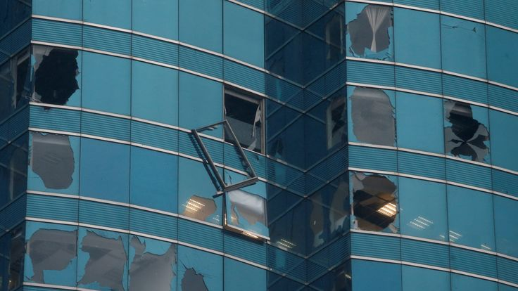 An office tower's windows are damaged following Typhoon Mangkhut in Hong Kong