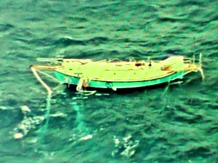 The capsized yacht Thuriya of solo sailor Abhilash Tomy