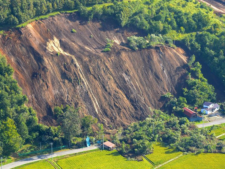 This picture shows an aerial view of houses damaged by a landslide in Atsuma town, Hokkaido prefecture on September 6, 2018, after an earthquake hit the northern Japanese island of Hokkaido
