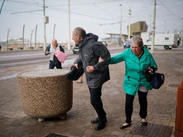 People in Blackpool struggled against the wind