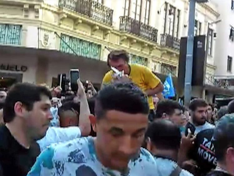 Video grab showing Brazilian right-wing presidential candidate Jair Bolsonaro gesturing after being stabbed