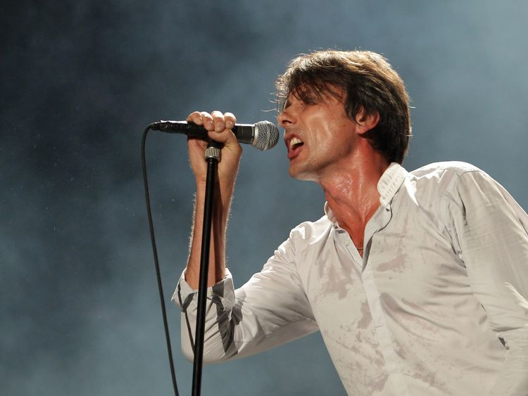 Brett Anderson of Suede performs on stage in 2013