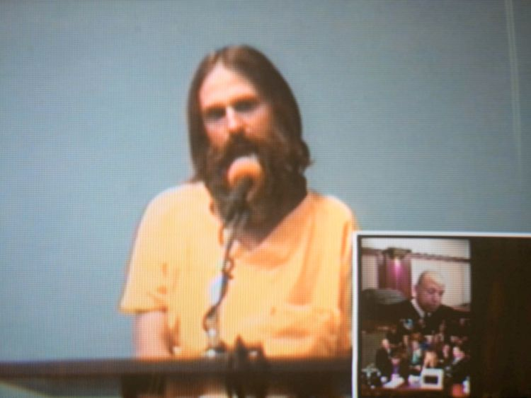 Brian David Mitchell, then 49, on a court closed-circuit television monitor during a 2003 hearing