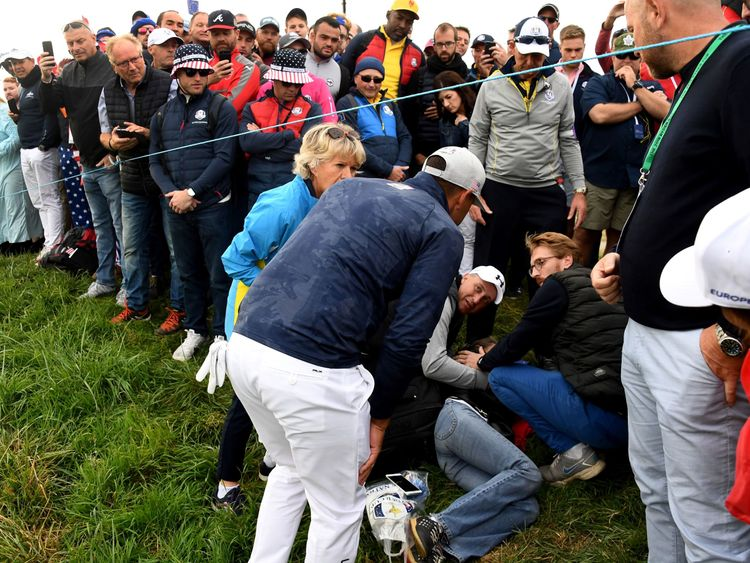 US golfer Brooks Koepka with an injured spectator