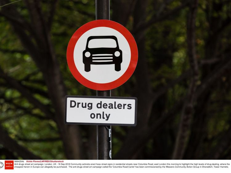 Community activists erect hoax street signs. Pic: Vickie Flores/LNP/REX/Shutterstock