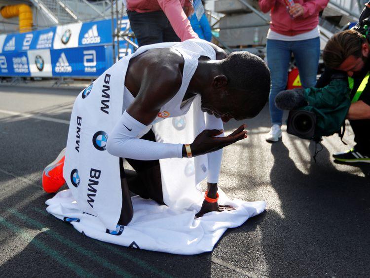 Kenya's Eliud Kipchoge celebrates winning the Berlin Marathon and breaking the World Record
