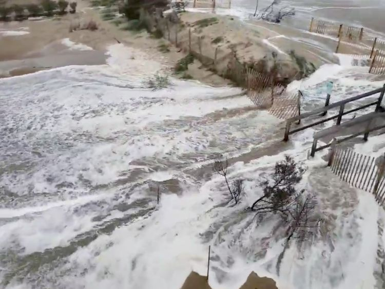 Waters come ashore in Avon, North Carolina. Pic: Jason Cole