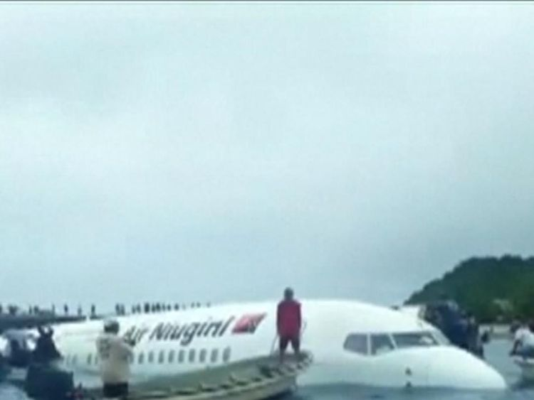 Boats and locals come to the rescue of all passengers and crew from a plane which crashed into a Micronesia lagoon